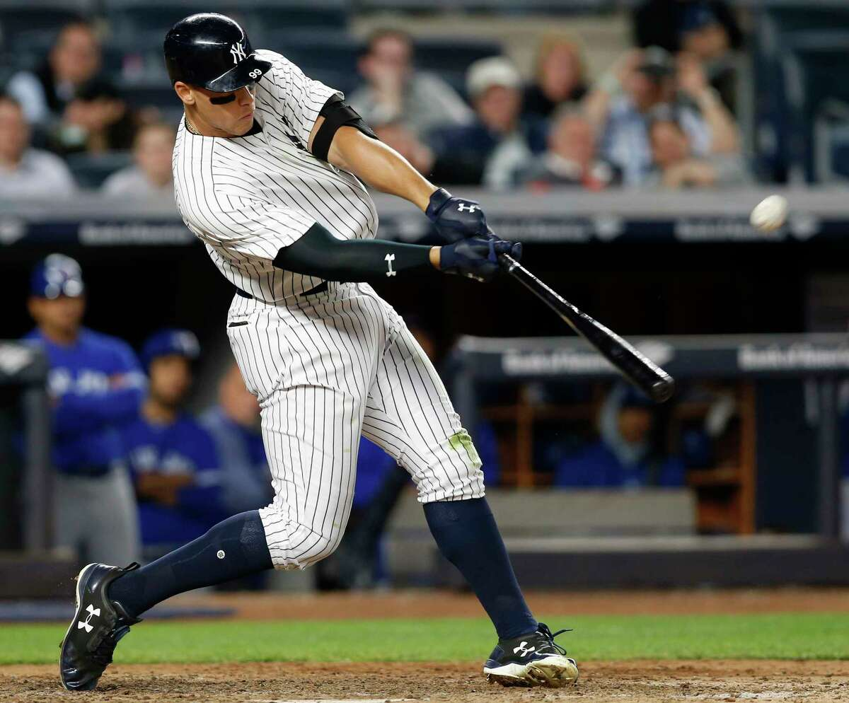 New York Yankees' Aaron Judge hits a three-run home run off Toronto Blue Jays relief pitcher Jason Grilli during the seventh inning of a baseball game in New York, Tuesday, May 2, 2017. It was Judge's second home run in the game. (AP Photo/Kathy Willens) ORG XMIT: NYY121