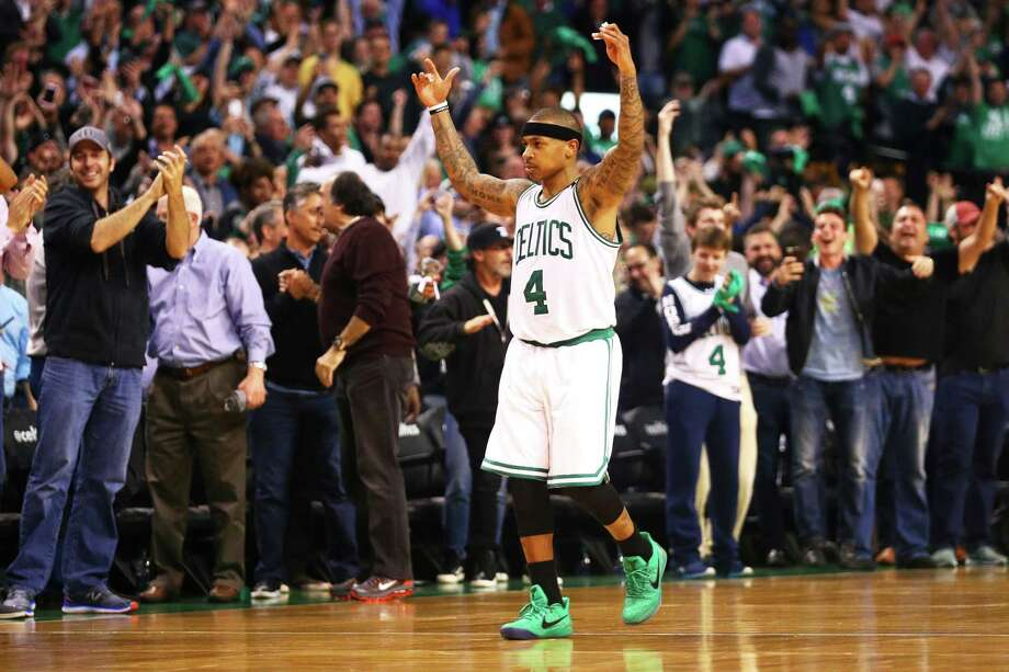 Isaiah Thomas trium-phantly leaves the court after becoming the fourth Celtic to surpass 50 points in a playoff game. Photo: Maddie Meyer, Staff / 2017 Getty Images