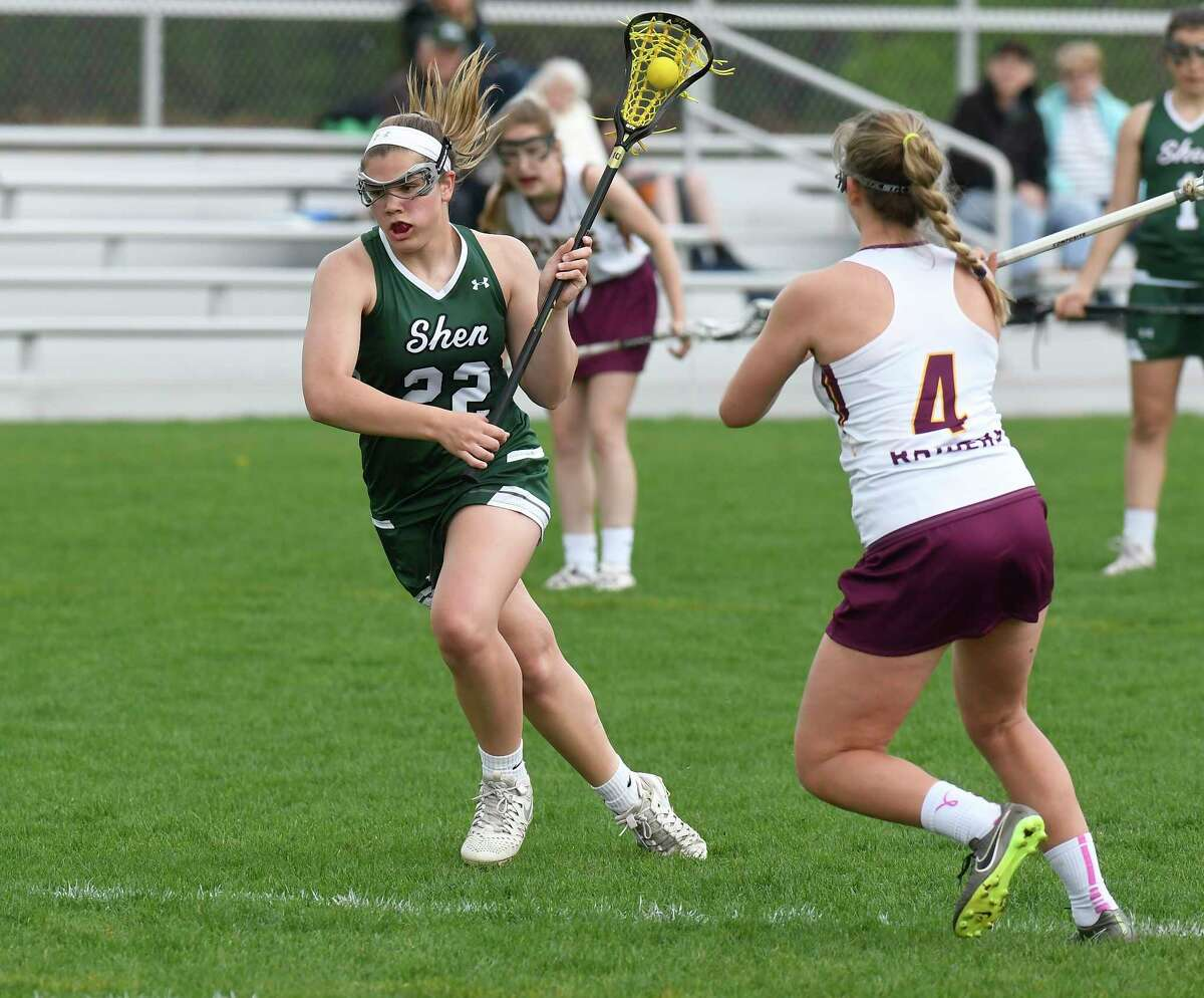 Shenendehowa's Mckenzie Ballard (22) moves the ball past Colonie's Victoria Servetas (4) during a Section II Class AA girls high school lacrosse game in Colonie, N.Y., Tuesday, May 2, 2017. (Hans Pennink / Special to the Times Union) ORG XMIT: HP101