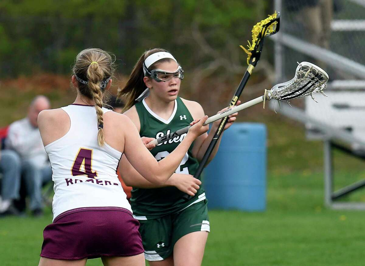 Colonie's Victoria Servetas (4) defends against Shenendehowa's Mckenzie Ballard (22) during a Section II Class AA girls high school lacrosse game in Colonie, N.Y., Tuesday, May 2, 2017. (Hans Pennink / Special to the Times Union) ORG XMIT: HP102