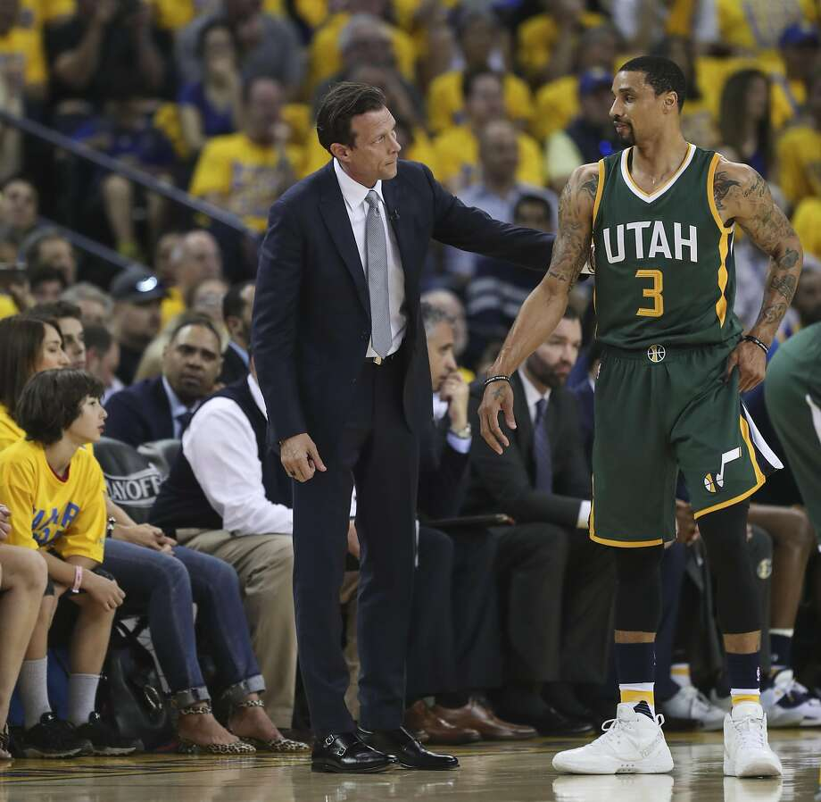 Utah Jazz Quin Snyder talks with George Hill in the second quarter during Game 1 of the Western Conference Semifinals 2017 NBA Playoffs at Oracle Arena on Tuesday