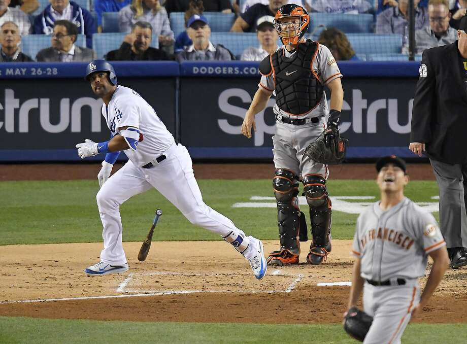 Los Angeles Dodgers' Franklin Gutierrez, left, hits a solo home run as San Francisco Giants starting pitcher Matt Moore, right, reacts and catcher Nick Hundley watches during the second inning of a baseball game, Tuesday, May 2, 2017, in Los Angeles. (AP Photo/Mark J. Terrill) Photo: Mark J. Terrill, Associated Press