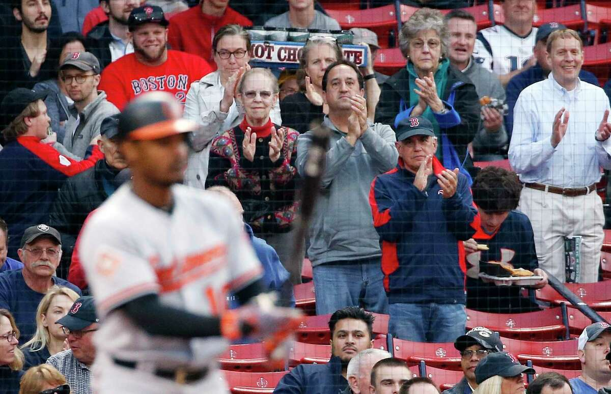 Boston fans give the Orioles' Adam Jones a warm welcome in the first inning Tuesday, a night after some hurled racially charged slurs at the outfielder.
