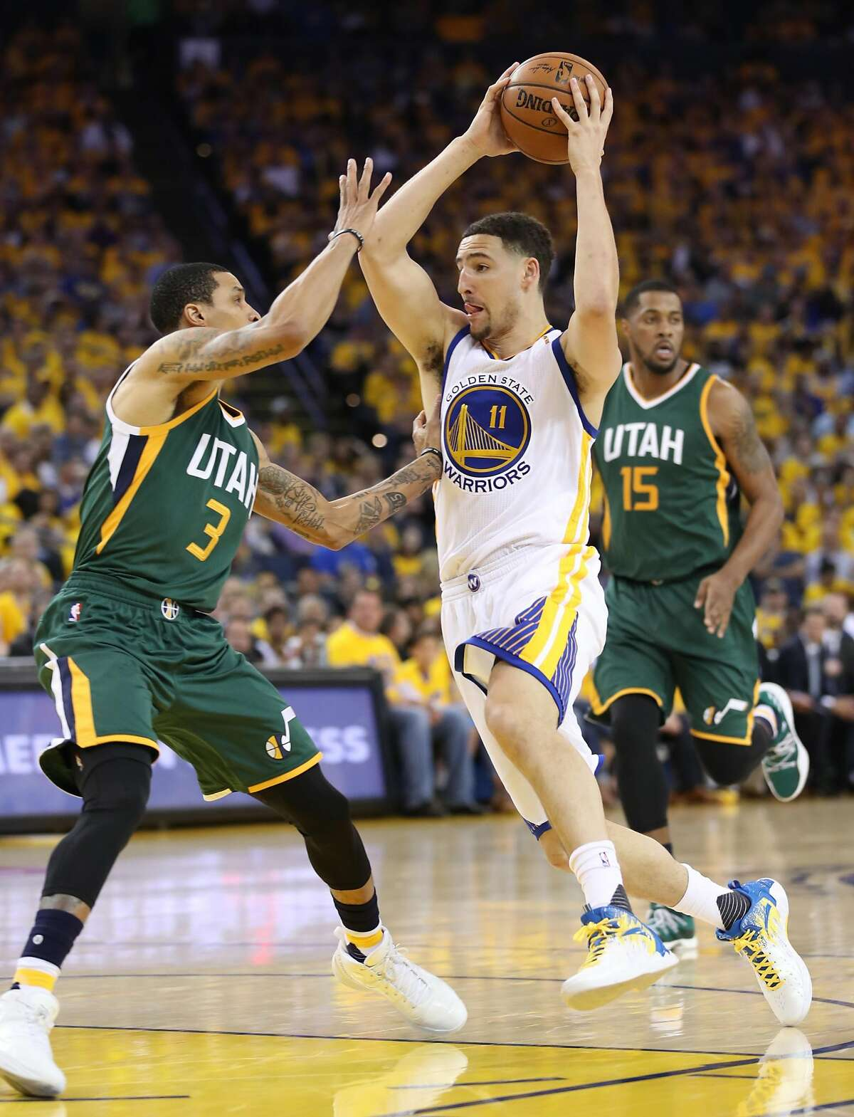 Golden State Warriors' Klay Thompson drives against Utah Jazz' George Hill in 4th quarter of Warriors' 106-94 win in Game 1 of NBA Western Conference Semifinals at Oracle Arena in Oakland, Calif., on Tuesday, May 2, 2017.