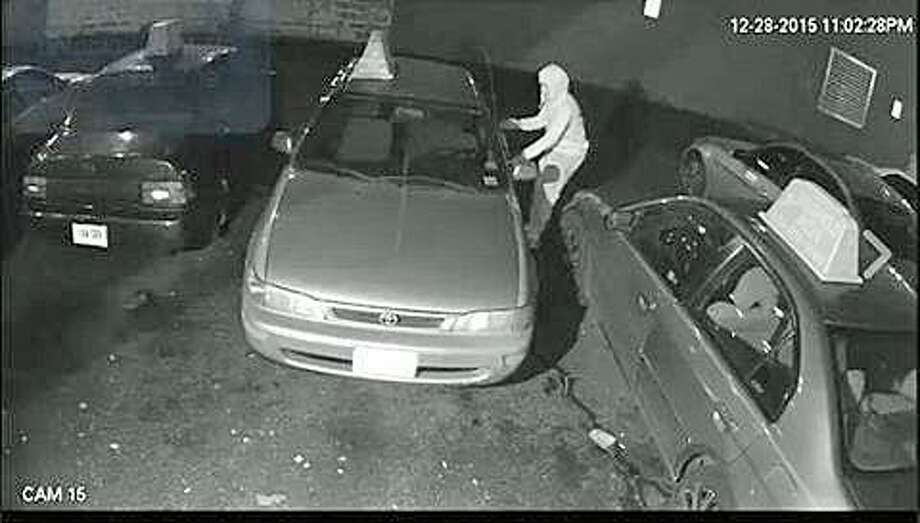 This image released by Stamford Police shows a person attempting to break into a vehicle. The picture is from a video of a theft where the suspect walked up and tried several vehicle doors until he found one that was unlocked. In the last several weeks, there have been a sharp increase in vehicle thefts and break-ins across Fairfield County. Photo: Wuennemann, Thomas /via Stamford Police