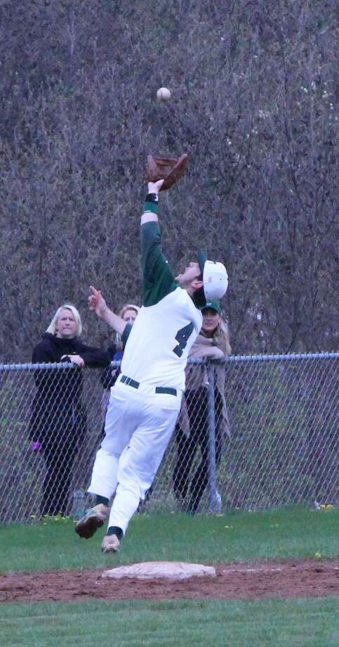 New Milford High School senior Payton Meyer holds an outstanding catch at third base to get the second out in the top of the seventh inning at the April 22 NMHS varsity baseball game against Newtown. New Milford won 8-7 in extra innings. Photo: Courtesy Of Katie Alzapiedi / The News-Times Contributed