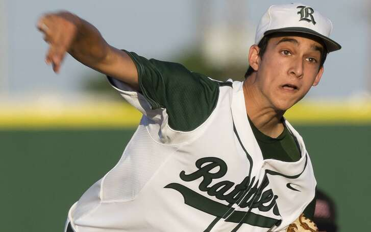 Reagan's Troy Montemayor pitches against Churchill on April 22, 2014, at Blossom Athleti Center in San Antonio.