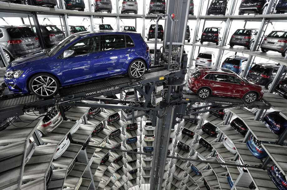 Volkswagen is intensifying efforts to rein in bloated costs and revive returns at the namesake VW brand. The effort is crucial as the company faces $24.7 billion in spending stemming from the September 2015 revelations that Volkswagen rigged millions of diesel cars to cheat on emissions tests. Photo: Michael Sohn /Associated Press / Copyright 2017 The Associated Press. All rights reserved.