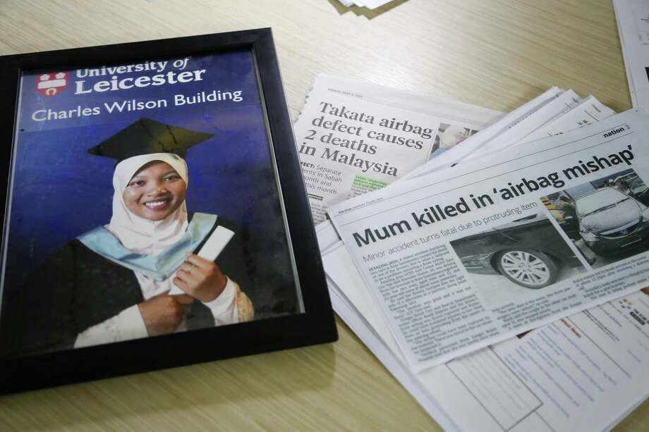 Shown is a portrait of Nida Fatin Mat Asis, a Malaysian doctor who died after being allegedly struck by a defective air bag inflator, next to news clippings in Kuala Lumpur, Malaysia. Photo: Lim Huey Teng /Associated Press / Copyright 2017 The Associated Press. All rights reserved.