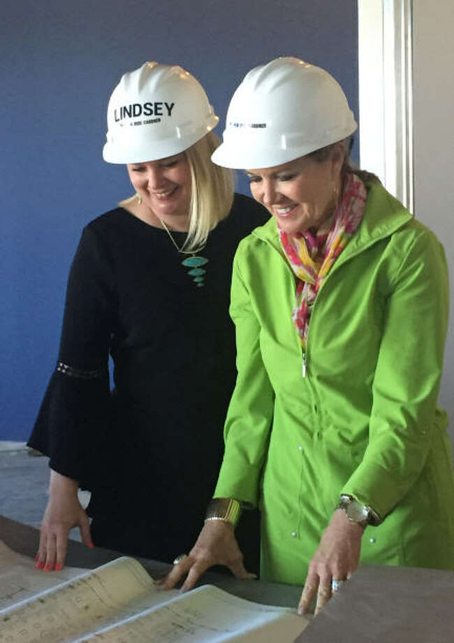 Heather R. Williams (left), newly named principal of Lamar CISD's Kathleen Joerger Lindsey Elementary School, reviews blueprints before taking Janet Burkett, Firethorne director of marketing, on a hard hat tour of the school. The school, which will open in August for the 2017-18 school year, will mark Lamar Consolidated ISD's first school in Firethorne, its 24th elementary district-wide and its first school with a Katy address. Photo: Firethorne