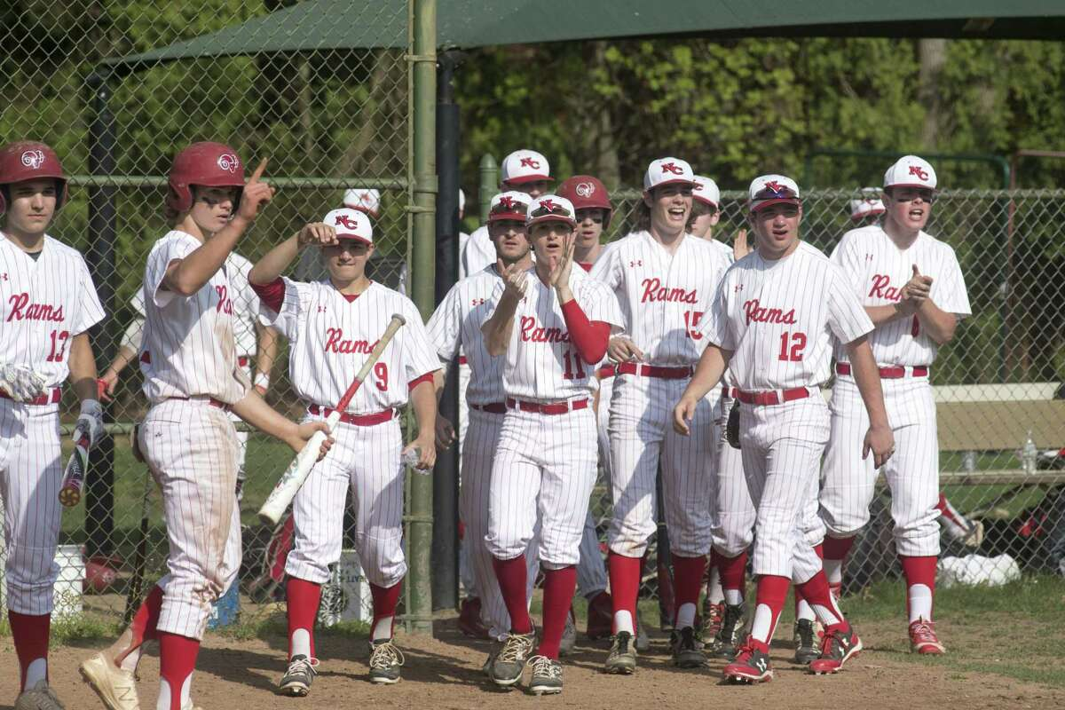 New Canaan's Griffin Arnone holds his finger in the air after bringing a run in and ultimately sealing the win for the Rams as New Canaan and Norwalk High Schools face off in a boys baseball game at Mead Park in New Canaan, Conn., May 1, 2017. New Canaan won the game 1-0.