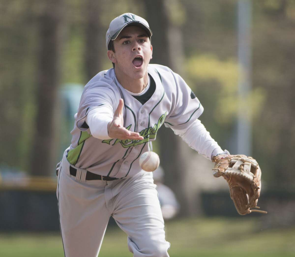 New Canaan's Nick Bozella throws the ball to first to make the out on Monday.