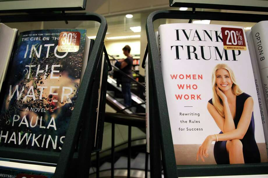 "A woman walks past a shelf displaying Ivanka Trump's book ""Women Who Work: Rewriting the Rules for Success"" at a Barnes and Noble bookstore in New York. Richard Painter, who served in an ethics role for President George W. Bush, said Trump has the right to write books, noting that the issue is if she is ""going to profit over using an official position to increase book sales."" He said he thought it was a stretch to call the book an ethics violation. Photo: Jewel Samad /AFP /Getty Images / AFP or licensors"