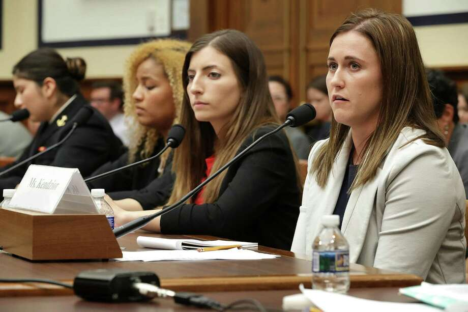 "WASHINGTON, DC - MAY 02:  Former U.S. Naval Academy Midshipman Annie Kendzior (R), testifies before the House Armed Services Committee's Subcommittee on Military Personnel with fellow sexual assault survivors (2nd R-L) former U.S. Military Academy cadets Stephanie Gross andAriana Bullard and Naval Academy Midshipman Second Class Shiela Craine in the Rayburn House Office Building on Capitol Hill May 2, 2017 in Washington, DC. Recruited as a student athelete, Kendzior was twice raped after enrolling at the Naval Academy in 2008. After reporting the crime she said the superintendent at the time told her to ""grow up."" The academy superintendents were called to testify following the release of a survey last month by the Pentagon that said 12.2 percent of academy women and 1.7 percent of academy men reported experiencing unwanted sexual contact during the 2015-16 academic year. The number of reports at West Point increased from 17 to 26, while reports at the Naval Academy ticked up from 25 to 28 over the last academic year.  (Photo by Chip Somodevilla/Getty Images) Photo: Chip Somodevilla, Staff / Getty Images / 2017 Getty Images"