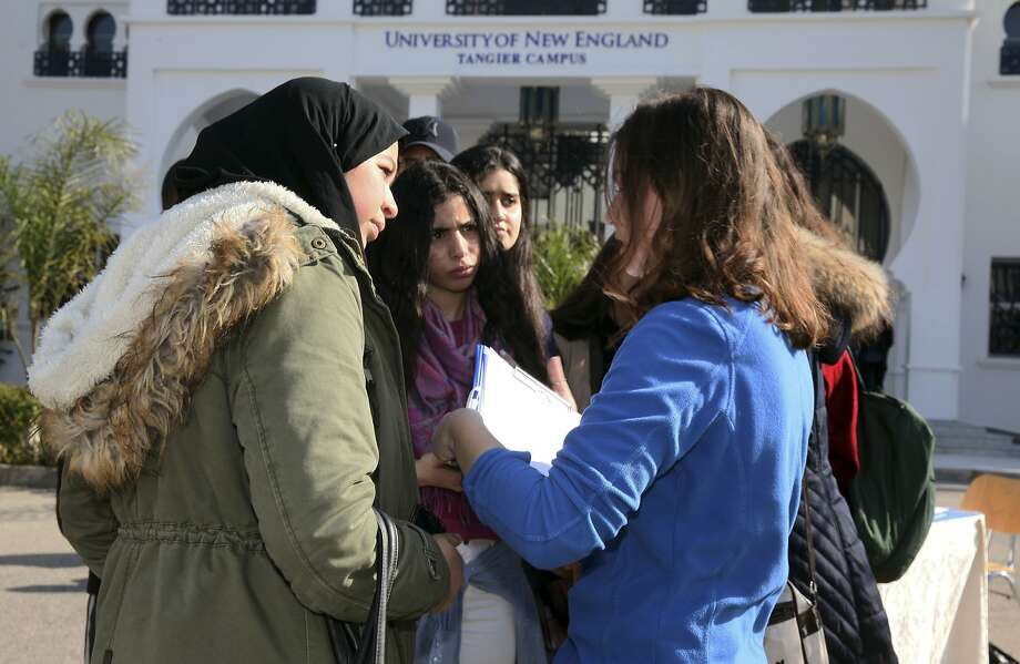 In this Feb. 18, 2017 photo provided by the University of New England, political science major and resident assistant Clancy Phillips, right, speaks to prospective students at an open house on the school's satellite campus in the Moroccan coastal city of Tangier. In response to concerns about anti-immigrant sentiment, some U.S. colleges are making new efforts to help international students feel welcome and reassure them of their safety. (Rachid Ouettassi/University of New England via AP) Photo: Rachid Ouettassi, Associated Press