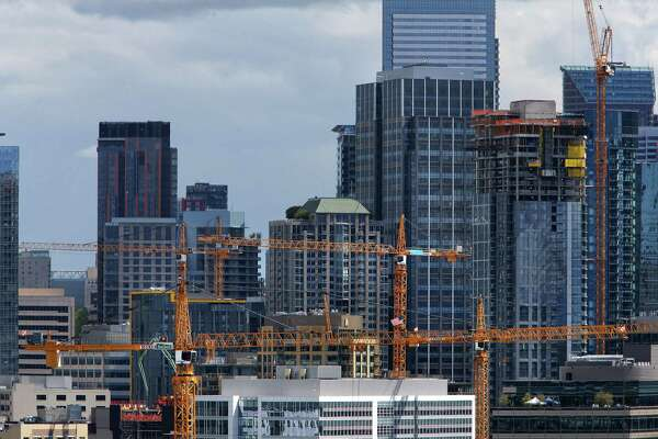 Crane dot the skyline of South Lake Union where Amazon and other companies are building at breakneck speeds. Photographed April 27, 2017.
