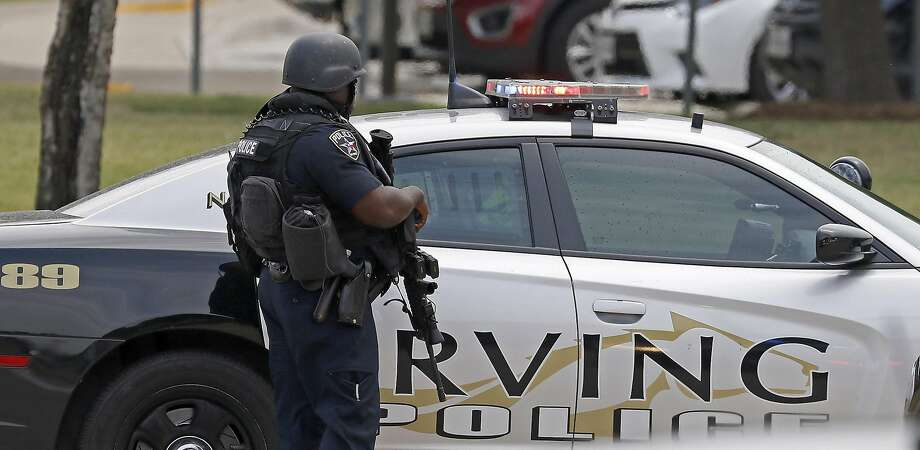 An Irving police officer works at the shooting scene on the North Lake College campus Wednesday, May 3, 2017 in Irving, Texas. (Jae S. Lee/The Dallas Morning News/TNS)   NO MAGAZINE SALES MANDATORY CREDIT; NO SALES; INTERNET USE BY TNS CONTRIBUTORS ONLY Photo: Jae S. Lee, TNS
