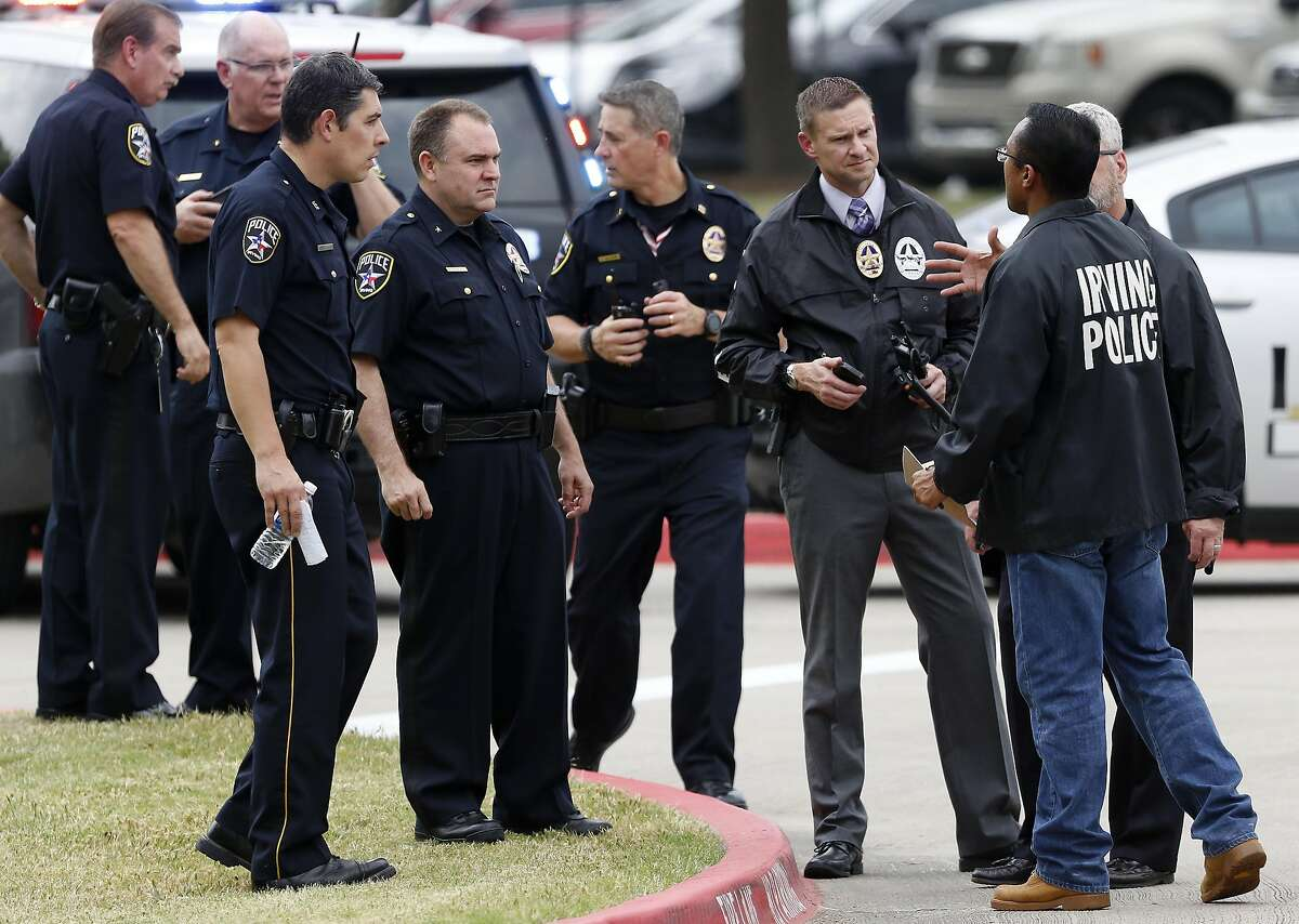 Irving police officers work at the shooting scene on the North Lake College campus in Irving, Texas, Wednesday, May 3, 2017. (Jae S. Lee/The Dallas Morning News)