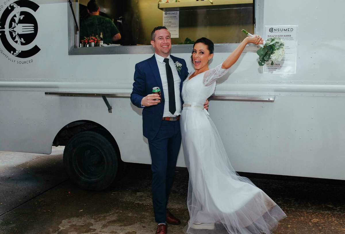 In the March 2017 photo provided by Julie Doniero, Bobby and Angelica Hughes celebrate their Houston wedding with local food truck, Consumed. (Julie Doniero via AP) ORG XMIT: NYLS312