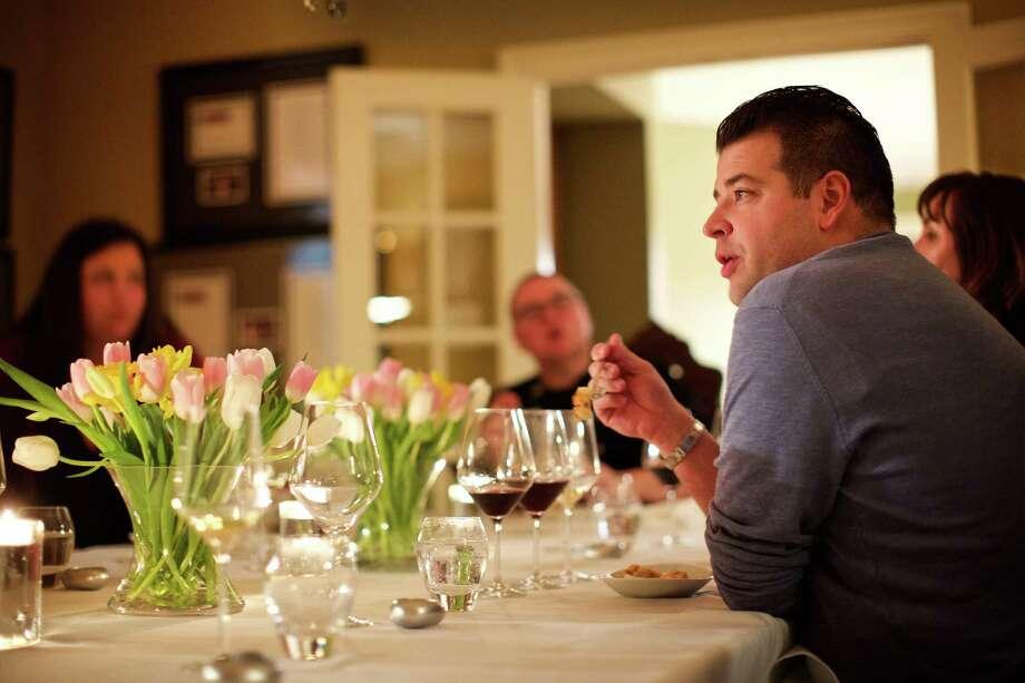 Masseria Chef Nick Stefanelli talks during Todd Hauptli's nine-course dinner. / For The Washington Post