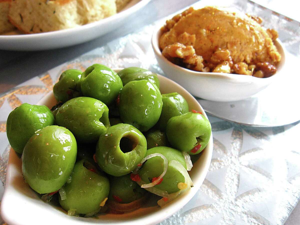 Marinated olives and 'nduja mascarpone with smoked walnuts from Battalion.