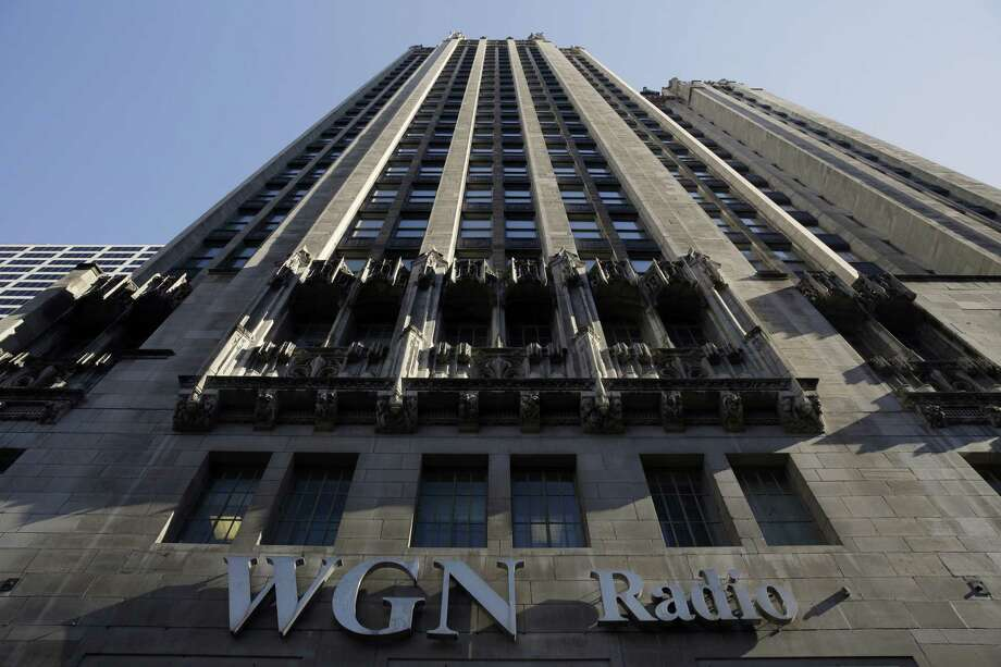 The WGN Radio sign appears on the side of Tribune Tower in downtown Chicago. TV station operator Tribune Media is at the center of a possible bidding war, following reports that Fox News owner 21st Century Fox and investment firm Blackstone may make a joint takeover bid for the company. Tribune owns or operates 42 local TV stations across the nation, including WGN. Photo: Kiichiro Sato /Associated Press / Copyright 2017 The Associated Press. All rights reserved.