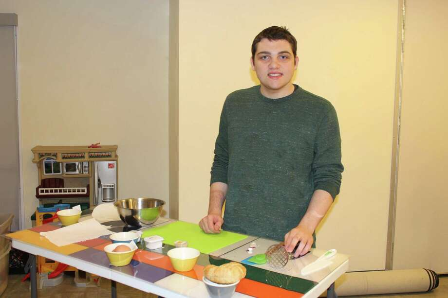 Vincent Bruzzese takes part in the Darien YMCA's Visual Mixing Bowl program for individuals with special needs. Photo: Contributed Photo / Darien News contributed