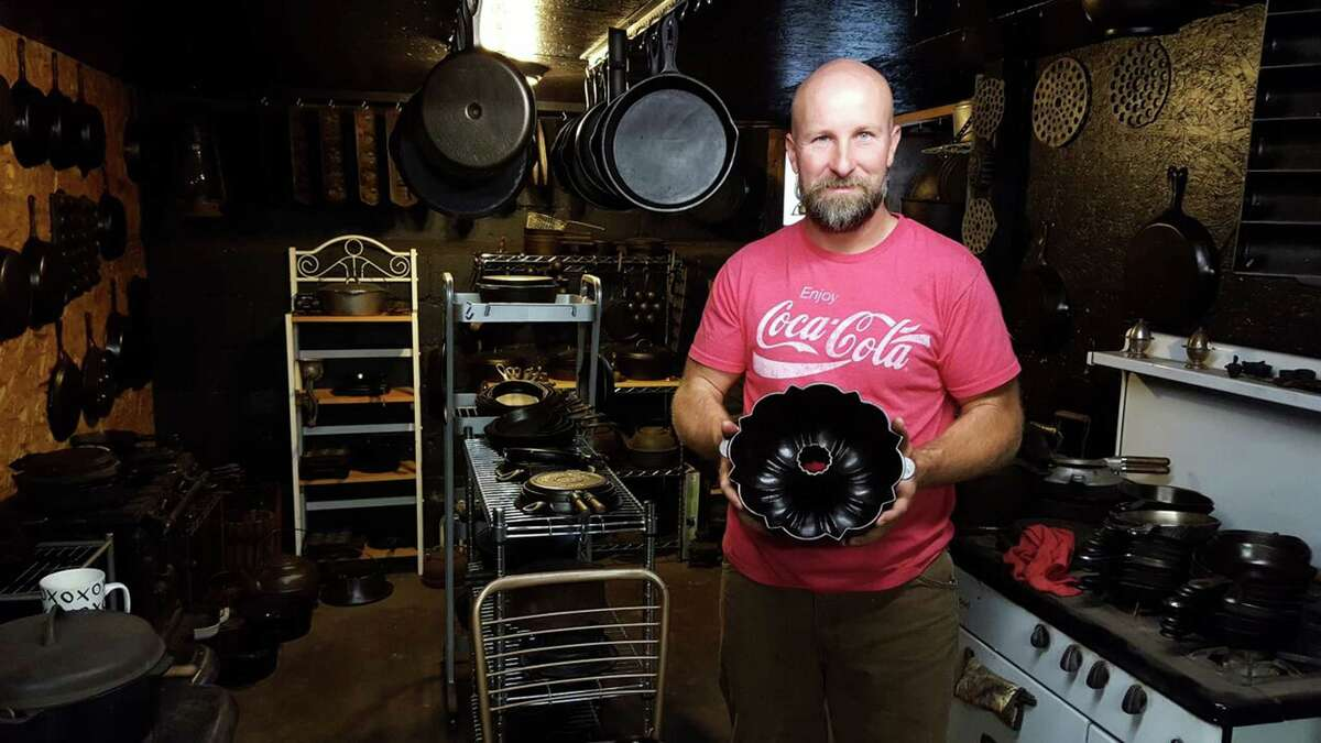Bobby Bulger, of Gloversville, has a soft spot for the black sheen of cast iron pieces. Restoring them to their soft metallic glows is a hobby of his. (Deanna Fox / Special to the Times Union)