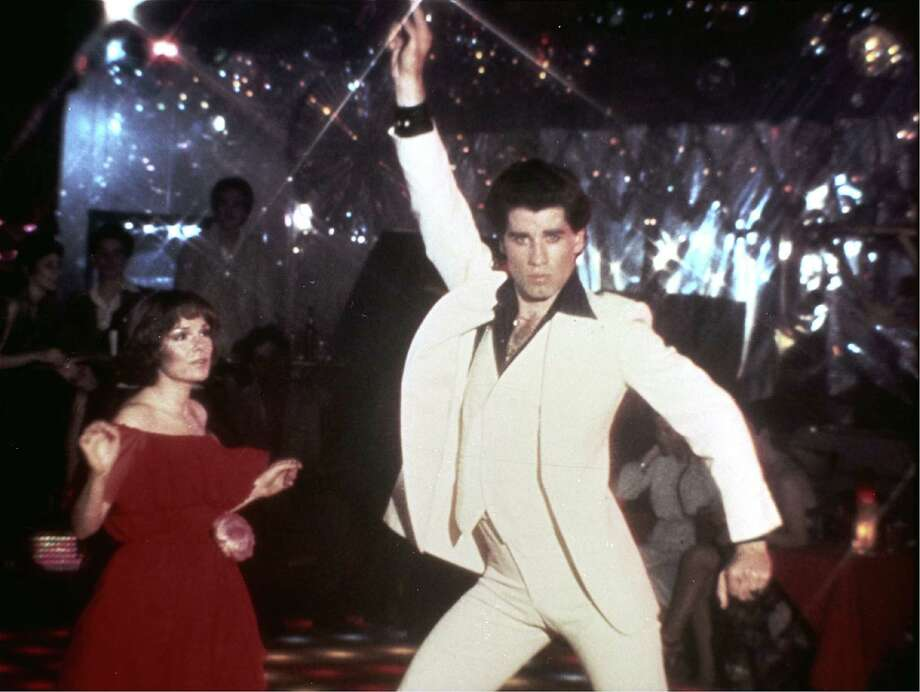 "** FILE ** In this 1977 file photo originally released by Paramount Pictures, John Travolta and Karen Lynn Gorney, left, are shown in a scene from, ""Saturday Night Fever.""   The Library of Congress announced early Tuesday Dec. 28, 2010 that the film will be preserved by the Library of Congress as part of its National Film Registry.        (AP Photo/Paramount Pictures) ** NO SALES ** Photo: Anonymous / AP2008"