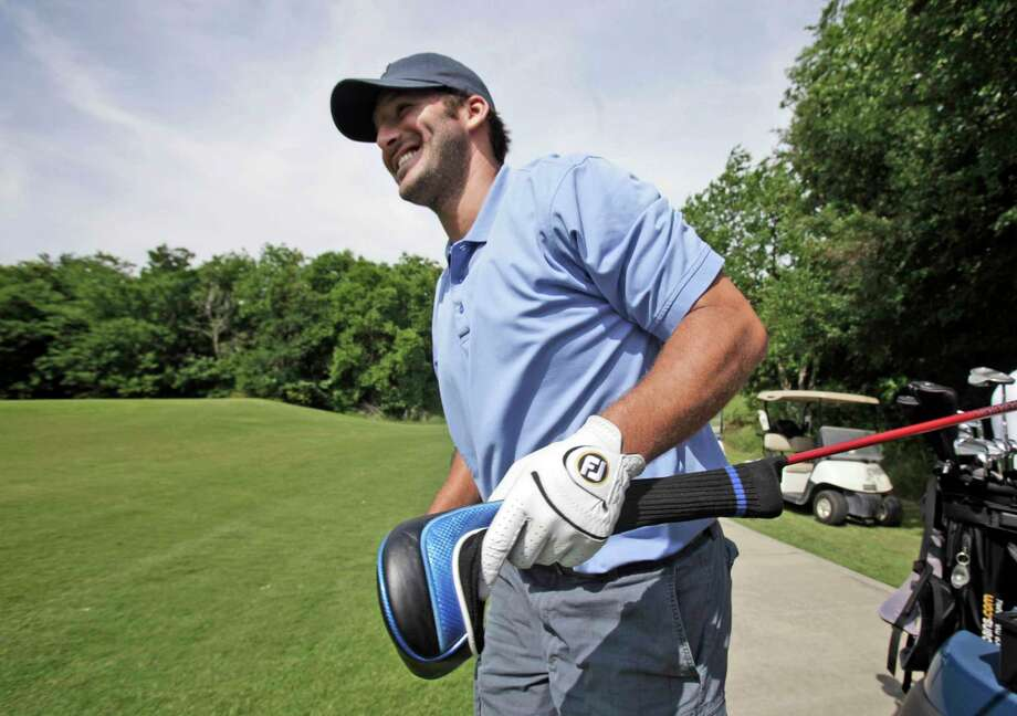 Dallas Cowboys quarterback Tony Romo carries a driver as he head to tee off on the 7th hole during the Dallas Cowboys Annual Sponsor Appreciation Golf Outing in Grapevine, Texas, Wednesday, May 12, 2010. (AP Photo/LM Otero) Photo: LM Otero, STF / AP