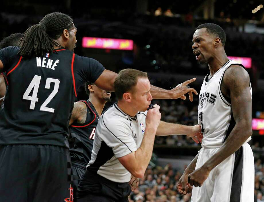 Houston Rocketsé• Nene and San Antonio Spurs' Dewayne Dedmon argue as official Josh Tiven moves in at the end of the third quarter during Game 1 in the Western Conference semifinals held Monday May 1, 2017 at the AT&T Center. Nene was ejected. Photo: Edward A. Ornelas, Staff / © 2017 San Antonio Express-News