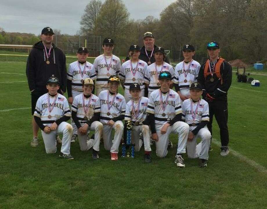The Trumbull Travel 12U baseball team, coached by Jeff John, Bob Buswell and Garrie Krueger, won the War by the Shore Tournament last weekend in East Lyme. In the championship game, Trumbull held off Shoreline Hammerheads-Wendall 12-11. Team members include, front row, from left, Matt Cummings, Ray Vicente, Michael Bagley Aidan Copeland, Connor Johnston and Colin Csizmadia; second row, from left, assistant coach Garrie Krueger, Ryen Duffy, Timmy Pearson, Jack Arcamone, Kevin Katragadda, Logan Huzi and head coach Jeff John; third row, assistant coach Bob Buswell. Photo: Contributed Photo