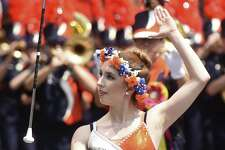A Brandeis High School majorette tosses her baton during the Battle of Flowers Parade on Friday, April 28, 2017.