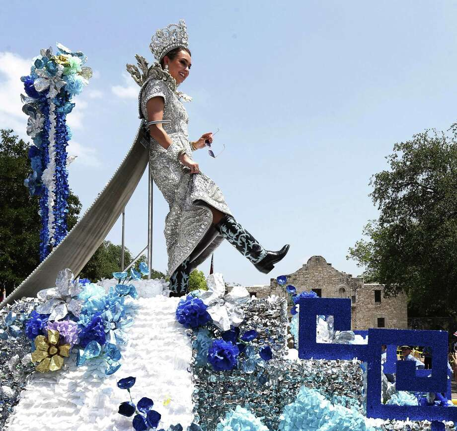 Frances Carolina Roberts, Princess of the Splendors of the Rio de la Plata, shows her boots for the crowd as her float passes by the Alamo during the 2017 Battle of Flowers parade on Friday, Apr. 28, 2017. (Kin Man Hui/San Antonio Express-News) Photo: Kin Man Hui,  Staff / San Antonio Express-News / ©2017 San Antonio Express-News