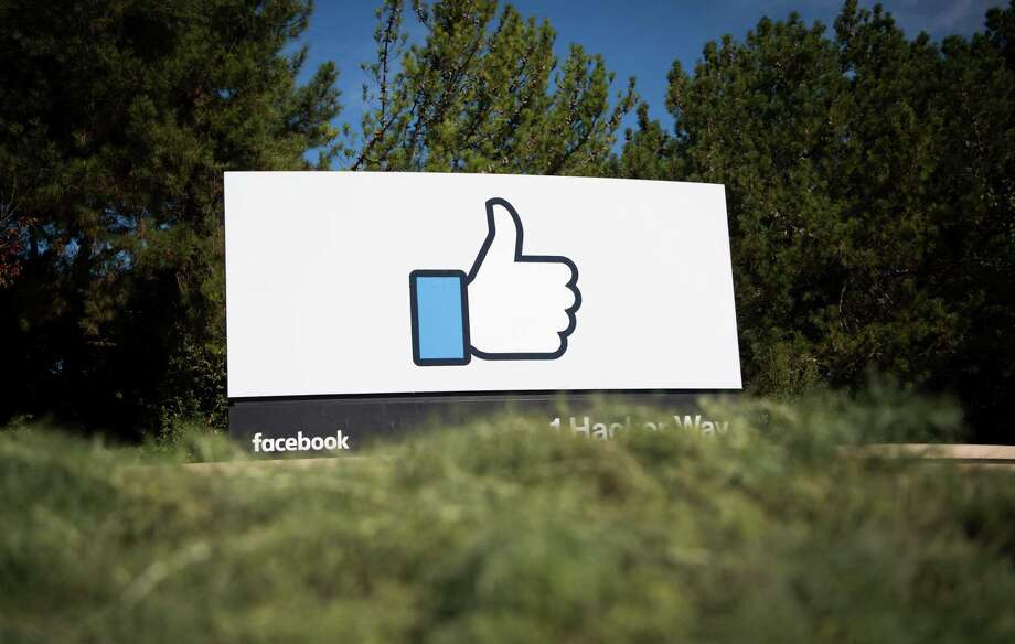 Facebook's first-quarter revenue beat analysts' estimates as monthly users jumped to 1.94 billion. It said sales climbed 49 percent to $8.03 billion, compared with the $7.83 billion analysts had projected. Net income rose to $3.06 billion, or $1.04 a share, compared with the 87-cent average estimate compiled by Bloomberg. Photo: Josh Edelson /AFP /Getty Images / AFP or licensors