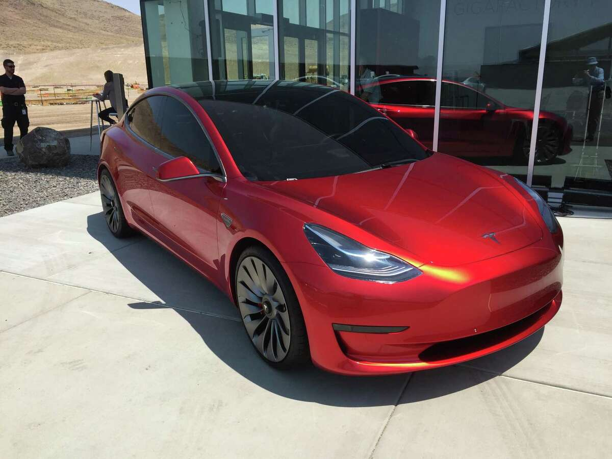 The Model 3 remains on schedule for output to start in July, Tesla said Wednesday as it reported first-quarter earnings results in a letter to shareholders. Weekly production of the car will reach 5,000 units at some point in 2017 and 10,000 per week at some point in 2018. Shown is a prototype of the Model 3.