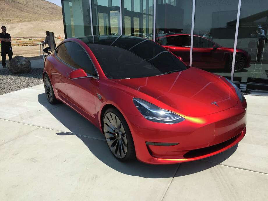 The Model 3 remains on schedule for output to start in July, Tesla said Wednesday as it reported first-quarter earnings results in a letter to shareholders. Weekly production of the car will reach 5,000 units at some point in 2017 and 10,000 per week at some point in 2018. Shown is a prototype of the Model 3. Photo: David R. Baker /San Francisco Chronicle