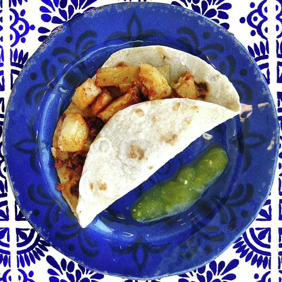 Potato and chorizo taco on a handmade flour tortilla from Carmelita's Mexican Restaurant. Photo: Mike Sutter /San Antonio Express-News