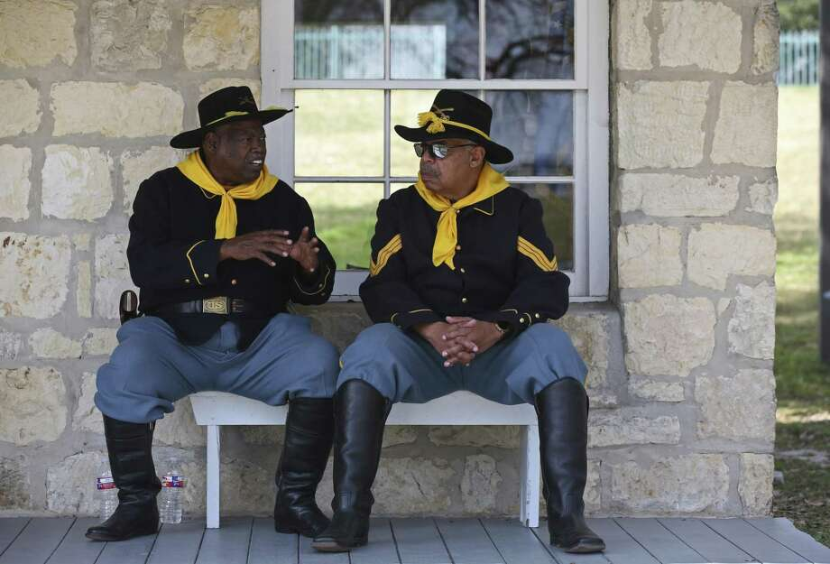 Bexar County Buffalo Soldiers Clay Leslie (left) and Dwight Zeigler participate in Buffalo Soldier Day at the University of Texas at San Antonio Institute of Texan Cultures, Feb. 12, 2017. Also participating in the event were members of the Texas Parks and Wildlife Buffalo Soldiers. Photo: Jerry Lara /San Antonio Express-News / © 2017 San Antonio Express-News