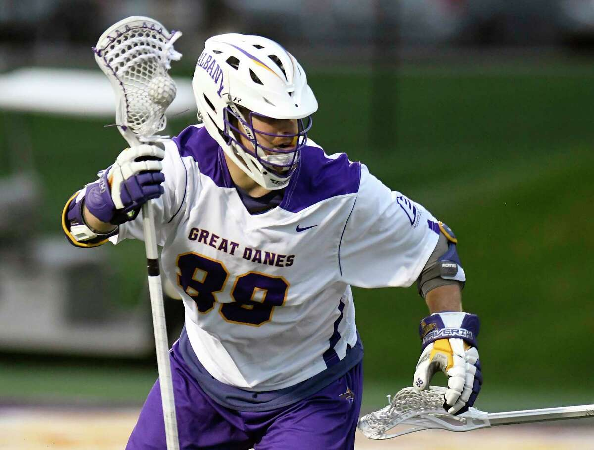 UAlbany's Bennett Drake (88) moves the ball against Hartford during a NCAA Division I college men's lacrosse game on Saturday, April 29, 2017, in Albany, N.Y. (Hans Pennink / Special to the Times Union) ORG XMIT: HP113