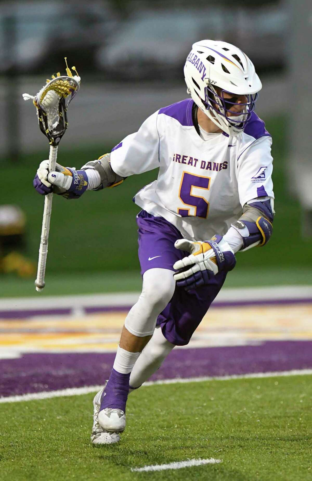 UAlbany's Connor Fields (5) moves the ball against Hartford during a NCAA Division I college men's lacrosse game on Saturday, April 29, 2017, in Albany, N.Y. (Hans Pennink / Special to the Times Union) ORG XMIT: HP114