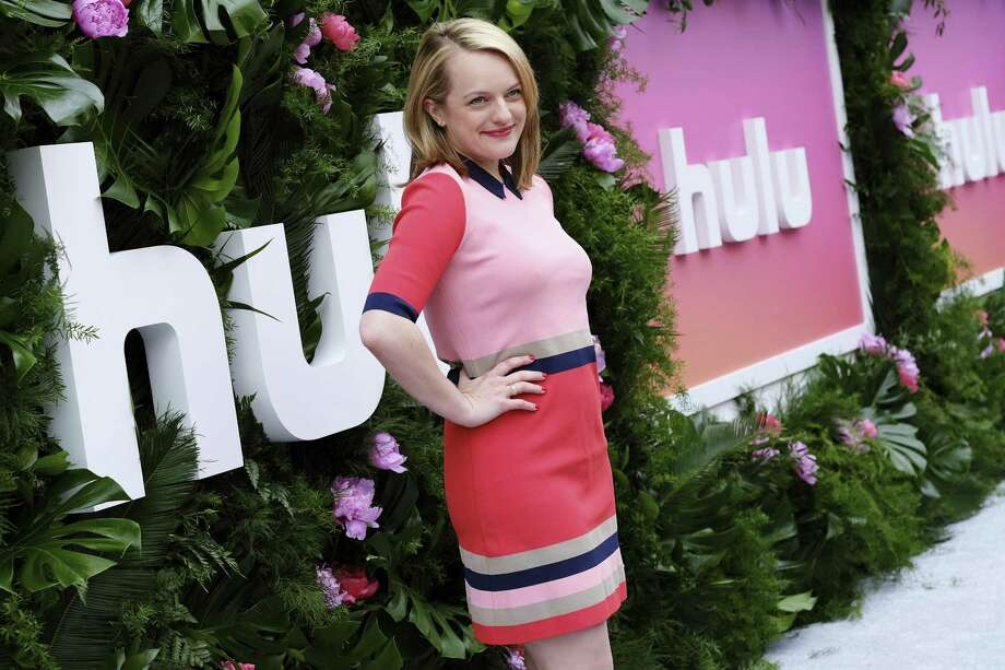 """Actress Elisabeth Moss, who stars in """"The Handmaid's Tale,"""" attends Hulu's 2017 Upfront Presentation on Wednesday in New York. Hulu has unveiled its long-awaited streaming app, Hulu with Live TV, which seeks to compete with the likes of SlingTV, DirecTV Now and YouTube TV. Photo: Evan Agostini /Associated Press / 2017 Invision"""