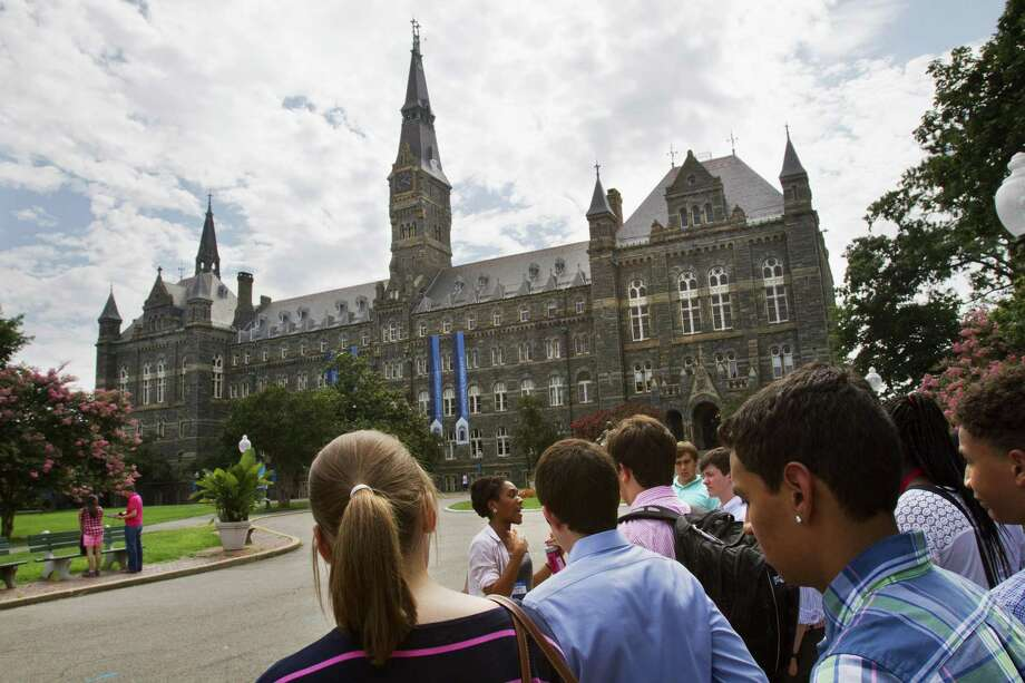 Prospective students tour Georgetown University's campus in Washington in 2013. The cost of college is going up everywhere, why President Trump should honor his pledge to address college debt. Photo: Jacquelyn Martin /Associated Press / AP