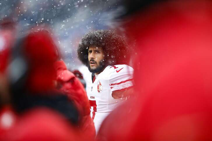CHICAGO, IL - DECEMBER 04:   Quarterback Colin Kaepernick #7 of the San Francisco 49ers stands on the sidelines in the first quarter against the Chicago Bears at Soldier Field on December 4, 2016 in Chicago, Illinois.  ~~