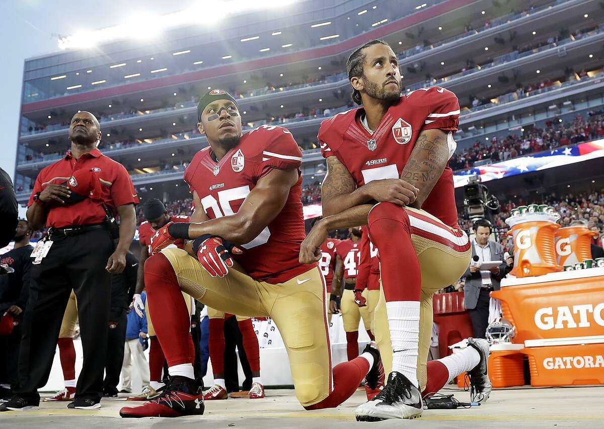 FILE - Int his Monday, Sept. 12, 2016, file photo, San Francisco 49ers safety Eric Reid (35) and quarterback Colin Kaepernick (7) kneel during the national anthem before an NFL football game against the Los Angeles Rams in Santa Clara. Gladys Knight, who will be singing the national anthem at this year's Super Bowl in Atlanta, criticized Colin Kaepernick in a statement published by Variety on Friday.