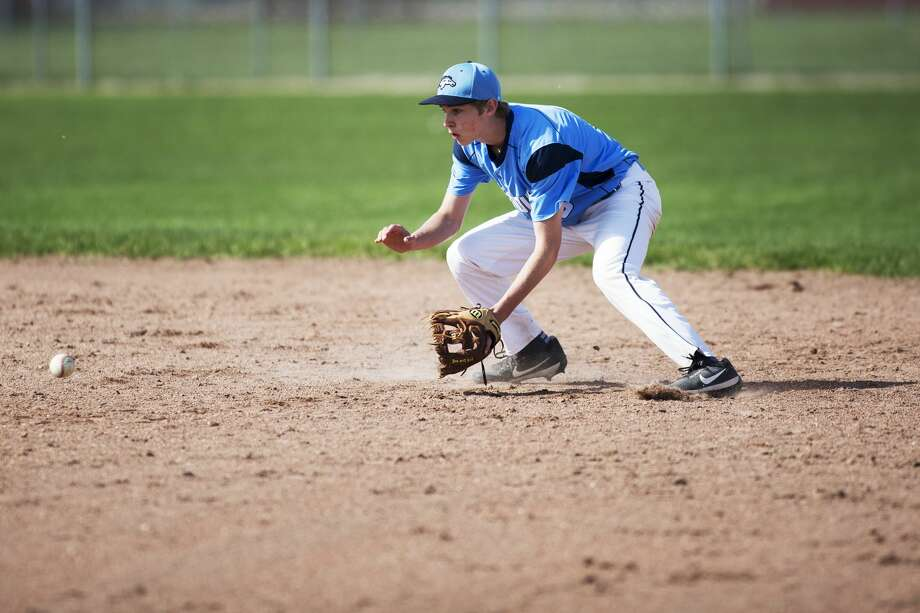 Meridian's Garrett Stockford fields a ground ball before turning a double play in a game against Beaverton High School at Beaverton High School on Wednesday. Photo: Theophil Syslo