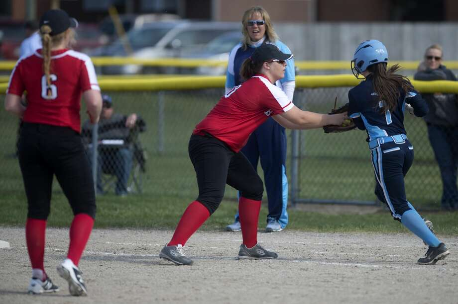 Beaverton's Karlie Schneider tags out Meridian runner Kassidy Zmikly in the sixth inning of the Wednesday afternoon game. Photo: Brittney Lohmiller/Midland Daily News/Brittney Lohmiller