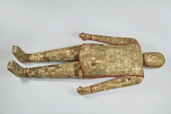 Jade suit, unearthed from Tomb 2, Dayun Mountain, Xuyi, Jiangsu