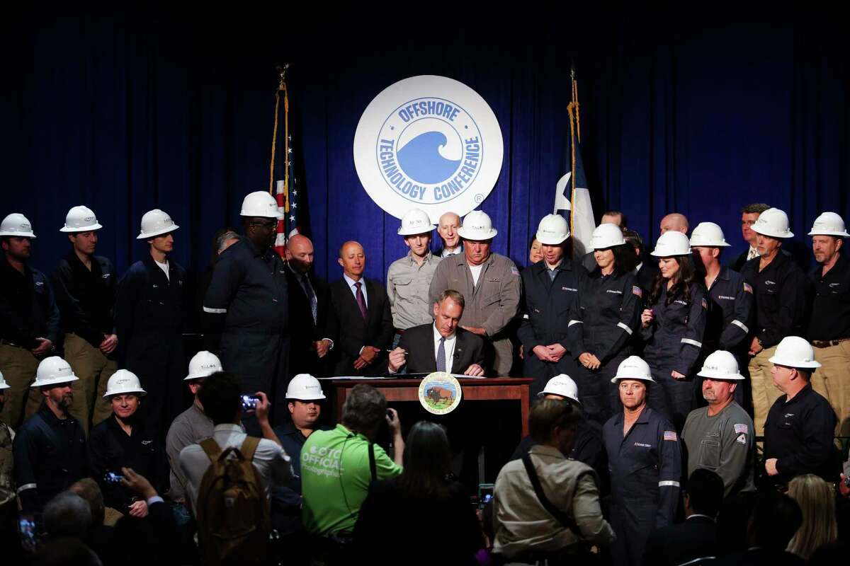 US Secretary of the Interior Ryan Zinke signs two secretarial orders during a panel at the Offshore Technology Conference at NRG Center Monday, May 1, 2017 in Houston. ( Michael Ciaglo / Houston Chronicle)