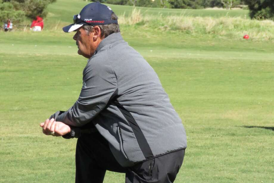 Plainview High School boys' golf coach Mike Lewis watches senior Ryan Castillo play in the Region 1-5A Tournament last week. Lewis is retiring after 26 years coaching the Bulldogs and 38 years in coaching overall. Photo: Photo Courtesy Of Betsy Lewis